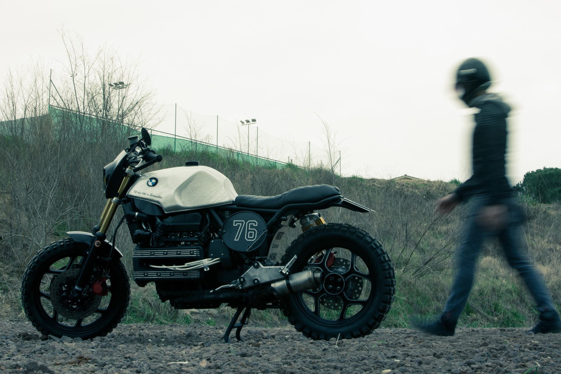 man-standing-near-black-and-white-bmw-standard-motorcycle-1289500