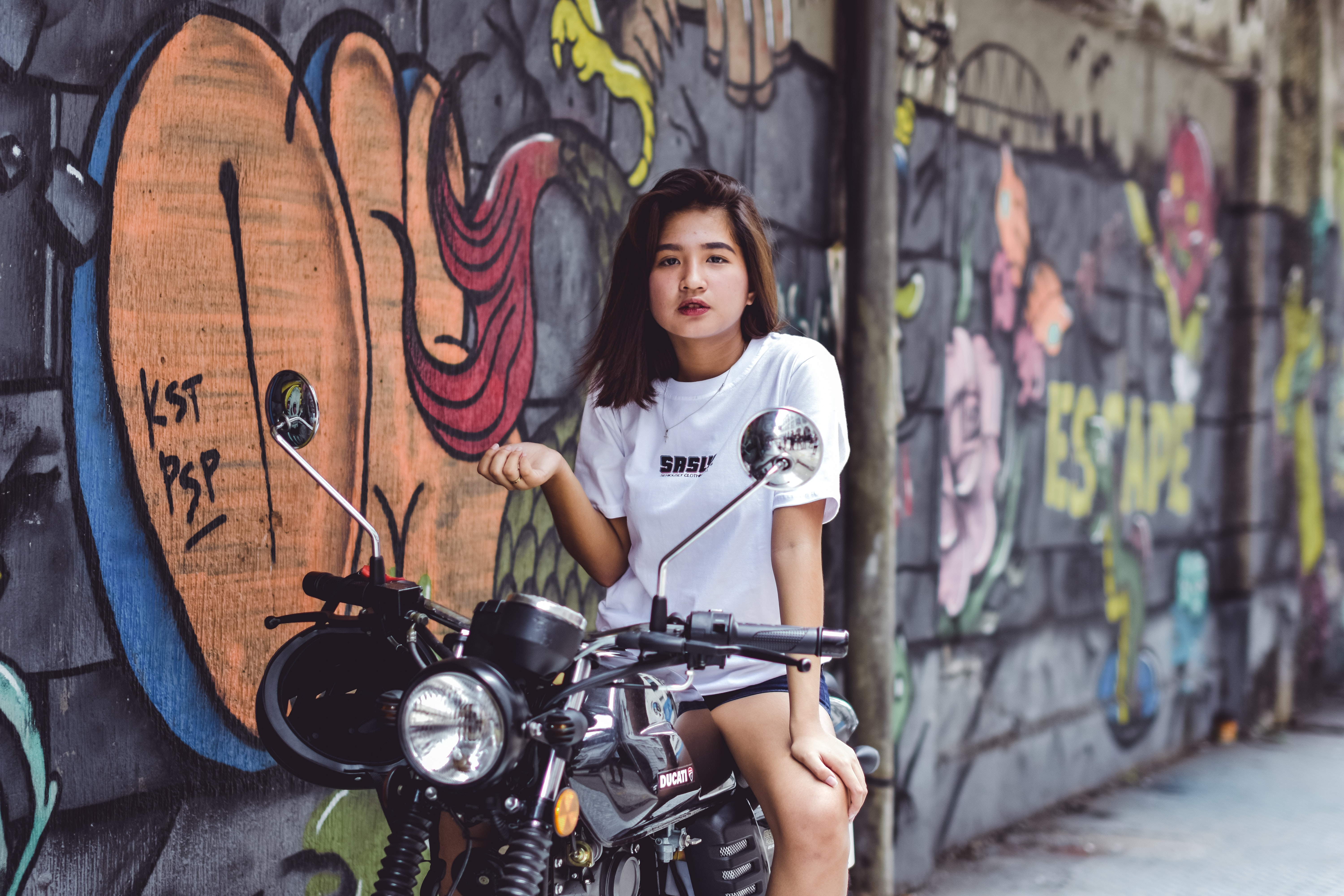 photo-of-woman-sitting-on-motorcycle-2315204