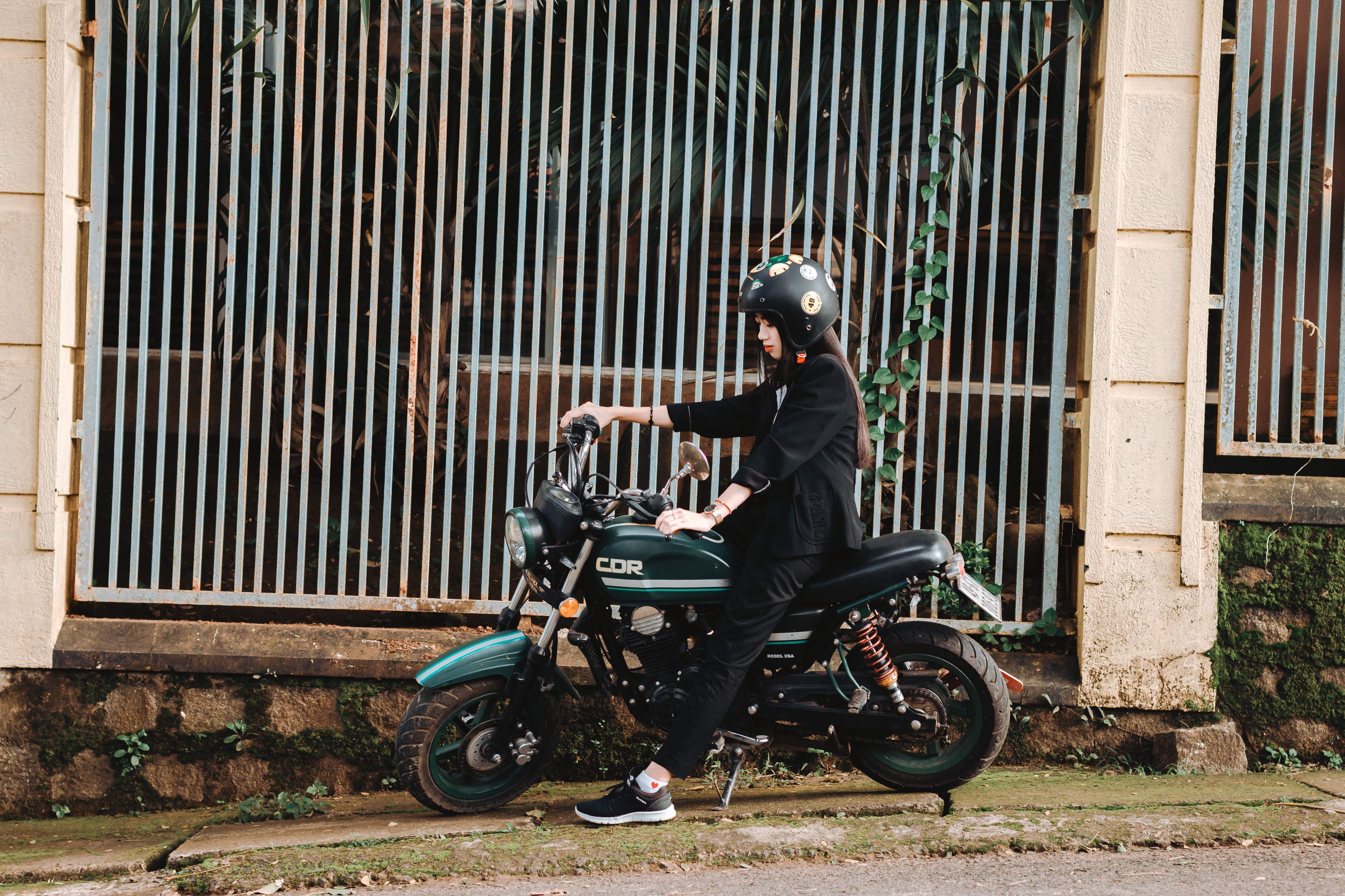 woman-riding-on-green-motorcycle-1400035